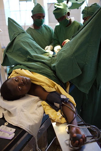 A woman undergoing surgery for fistula