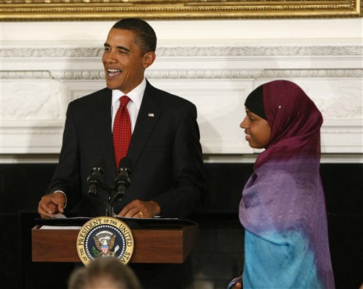 President Barack Obama introduces Bilqis Abdul-Qaadir, a University of Memphis student, who, as a high school student in Massachusetts, broke the high school career points record in women's basketball for her state, as he makes remarks during a dinner celebrating Ramadan in the State Dining Room of the White House in Washington, Tuesday, Sept. 1, 2009.(AP Photo/Gerald Herbert)