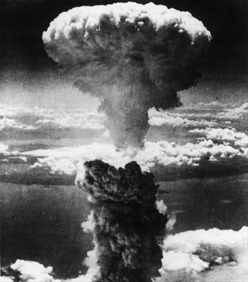 The mushroom cloud rising over Nagasaki, Japan. The city of Nagasaki was the target of the world's second atomic bomb attack at 11:02 a.m. on August 9, 1945.