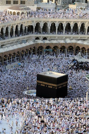 Hundreds of thousands of Muslims pilgrims circle the Kaaba inside and outside the Grand Mosque during the last week of Ramadan in Mecca, Saudi Arabia, Wednesday, Sept. 16, 2009. (AP Photo/Issa Mohammad)