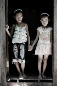 Someone's daughters at the doorway of a brothel in Cambodia [Agape International Mission]