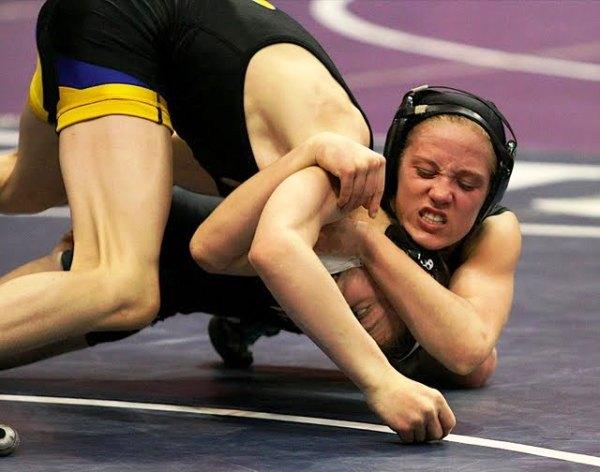 Elissa Reinsma defeats John Weeding in a Minnesota high school wrestling tournament in March 2009