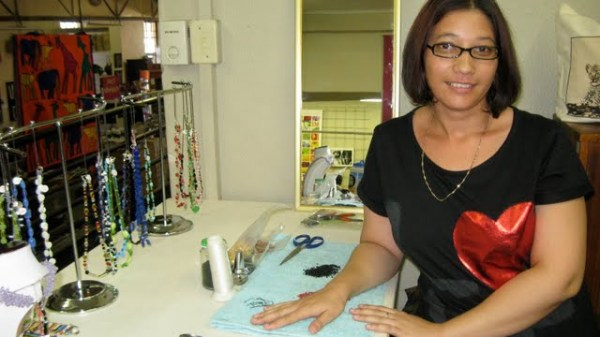 Martie beading and selling her work at the Craft Center in Windhoek, Namibia