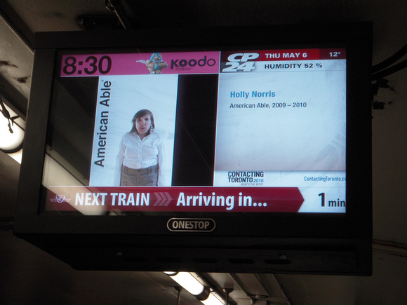 image from American Able series showing on a screen in a Toronto transit station